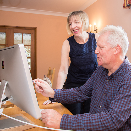 Pam Allen and a client at their home office in Crewe, Cheshire